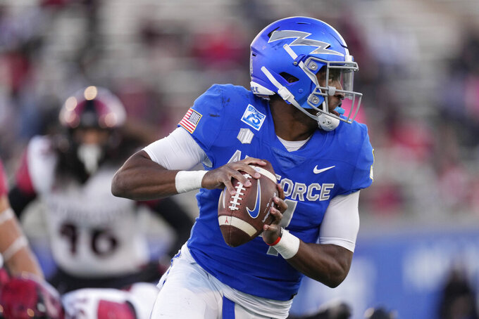 Air Force quarterback Haaziq Daniels rolls out for a pass against San Diego State in the first half of an NCAA college football game Saturday, Oct. 23, 2021, at Air Force Academy, Colo. (AP Photo/David Zalubowski)