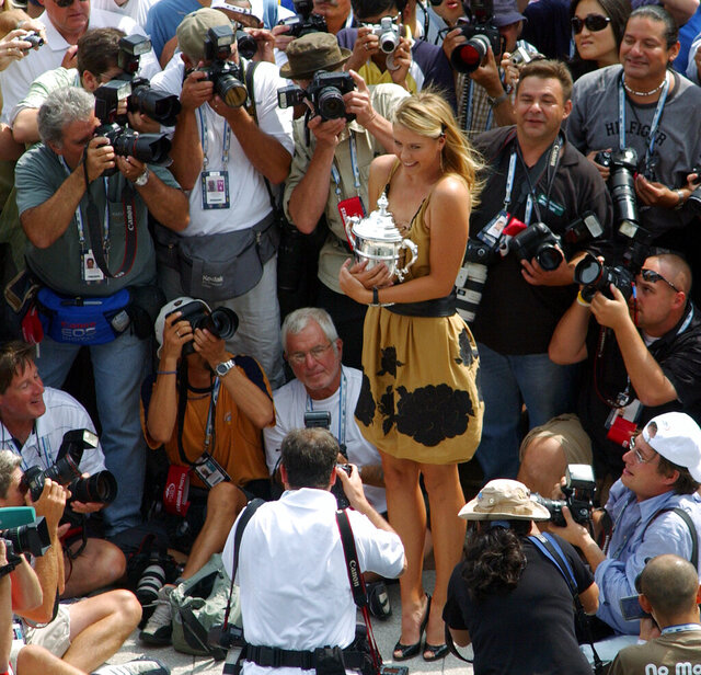 "FILE - In this Sept. 10, 2006, file photo, Maria Sharapova, the U.S. Open tennis women's singles champion, poses with her trophy in New York. Sharapova is retiring from professional tennis at the age of 32 after five Grand Slam titles and time ranked No. 1. She has been dealing with shoulder problems for years. In an essay written for Vanity Fair and Vogue about her decision to walk away from the sport, posted online Wednesday, Feb. 26, 2020, Sharapova asks: ""How do you leave behind the only life you've ever known?"" (AP Photo/Osamu Honda, File)"
