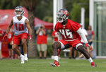 Tampa Bay Buccaneers linebacker Devin White (45) covers wide receiver Scott Miller (10) during an NFL football training camp practice Saturday, July 27, 2019, in Tampa, Fla. (AP Photo/Chris O'Meara)