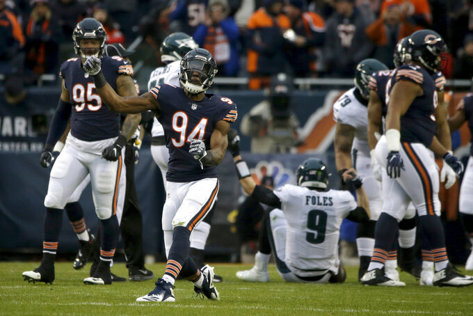 Chicago Bears linebacker Leonard Floyd (94) reacts after a sack of Philadelphia Eagles quarterback Nick Foles (9) during the first half of an NFL wild-card playoff football game against the Philadelphia Eagles Sunday, Jan. 6, 2019, in Chicago. (AP Photo/David Banks)