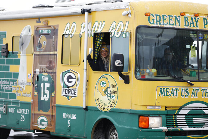 Packer fans arrive at Lambeau Field before the NFC championship NFL football game between the Tampa Bay Buccaneers and Green Bay Packers in Green Bay, Wis., Sunday, Jan. 24, 2021. (AP Photo/Mike Roemer)