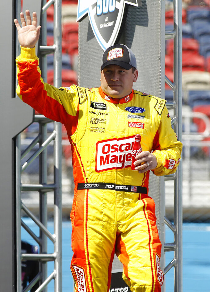 Ryan Newman waves to the crowd during driver introductions prior to the start of the NASCAR Cup Series auto race at ISM Raceway, Sunday, March 10, 2019, in Avondale, Ariz. (AP Photo/Ralph Freso)