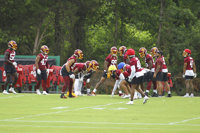 Washington football team defensive end Chase Young (99) is seen during an NFL football practice at Inova Sports Performance Center in Ashburn, Va., Wednesday, June 9, 2021. (AP Photo/Luis M. Alvarez)