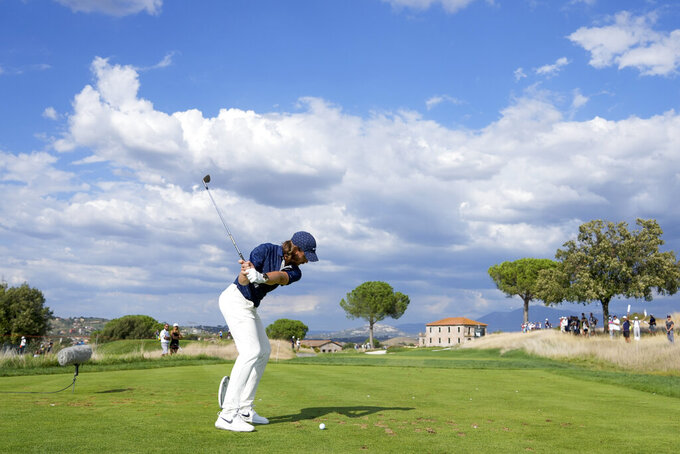 Tommy Fleetwood hits a tee shot during the fourth round of the Italian Open golf tournament, in Guidonia, in the outskirts of Rome, Sunday, Sept. 5, 2021. The Italian Open took place on the redesigned Marco Simone course just outside Rome that will host the 2023 Ryder Cup. (AP Photo/Andrew Medichini)