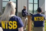 National Transportation Safety Board Vice Chairman Bruce Landsberg, center, speaks during a news conference, Monday, Sept. 27, 2021, in Chester, Mont., near the scene where an Amtrak train derailed Saturday, killing three people and injuring others. (AP Photo/Ted S. Warren)