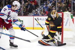 Vancouver Canucks goalie Jacob Markstrom, right, of Sweden, stops New York Rangers' Filip Chytil, of the Czech Republic, during the first period of an NHL hockey game Saturday, Jan. 4, 2020, in Vancouver, British Columbia. (Darryl Dyck/The Canadian Press via AP)