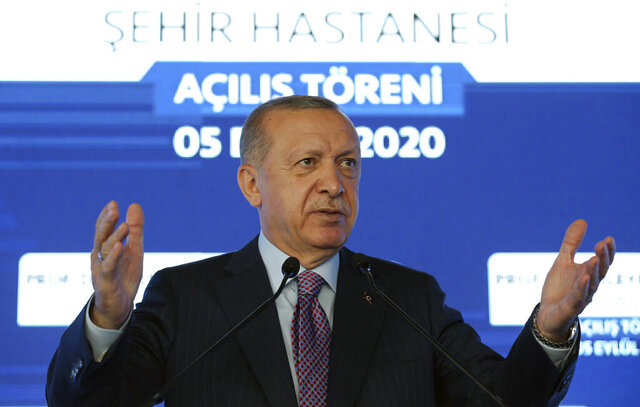 Turkey's President Recep Tayyip Erdogan speaks at a hospital's opening ceremony, in Istanbul, Saturday, Sept. 5, 2020. Erdogan on Saturday warned Greece to enter talks over disputed eastern Mediterranean territorial claims or face the consequences.