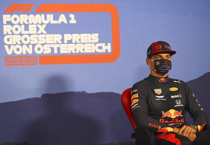 Red Bull driver Max Verstappen of the Netherlands, wearing a mask against the spread of the coronavirus, attends a press conference after he clocked the third fastest time during the qualifying session at the Red Bull Ring racetrack in Spielberg, Austria, Saturday, July 4, 2020. The Austrian Formula One Grand Prix will be held on Sunday. (Mario Renzi/Pool via AP)