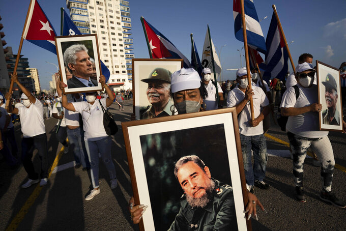 People attend a cultural-political event on seaside Malecon Avenue with thousands of people in a show of support for the Cuban revolution six days after the uprising of anti-government protesters across the island, in Havana, Cuba, Saturday, July 17, 2021 (AP Photo/Eliana Aponte)