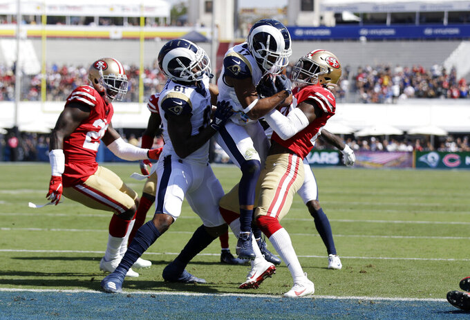 Los Angeles Rams wide receiver Robert Woods (17) score a a touchdown against the San Francisco 49ers during the first half of an NFL football game Sunday, Oct. 13, 2019, in Los Angeles. (AP Photo/Alex Gallardo)