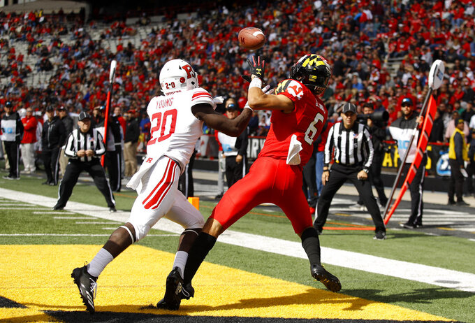 Maryland wide receiver Jeshaun Jones, right, catches a pass for a touchdown in front of Rutgers defensive back Avery Young in the second half of an NCAA college football game, Saturday, Oct. 13, 2018, in College Park, Md. Maryland won 34-7. (AP Photo/Patrick Semansky)