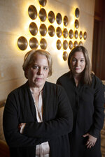 In this Tuesday, Nov. 12, 2019, photo, Roberta Kaplan, left, a lead lawyer in a lawsuit against white nationalists, and Amy Spitalnick, executive director of Integrity First for America, the nonprofit funding the case, pose in Atherton, Calif. The lawsuit was brought by a group of plaintiffs against individuals involved in planning a 2017 white nationalist rally in Charlottesville, Va., in which one counter-protester was killed and several others were injured. (AP Photo/D. Ross Cameron)