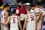 Stanford head coach Jerod Haase speaks with his players at a timeout during the second half of an NCAA college basketball game against California in the first round of the Pac-12 men's tournament Wednesday, March 10, 2021, in Las Vegas. (AP Photo/John Locher)