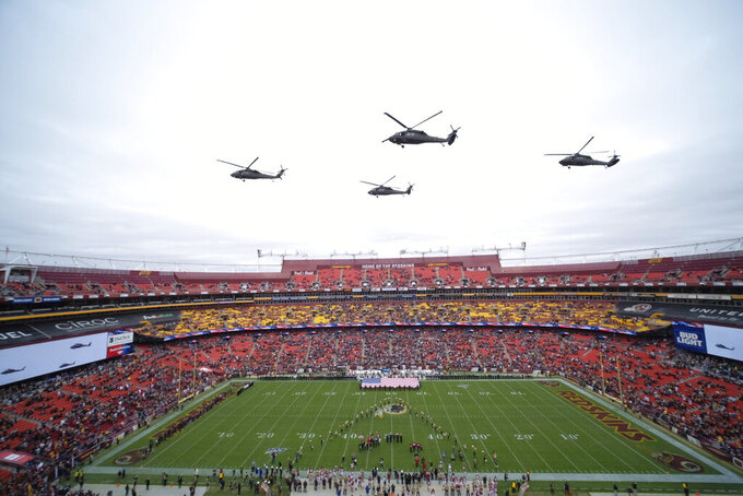 U.S. Military flyover FedEx Field before the first half of an NFL football game between the Washington Redskins and the New York Jets Sunday, Nov. 17, 2019, in Landover, Md. (AP Photo/Mark Tenally)