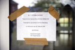 An announcement indicates that the school was closed due to the coronavirus is displayed at the Gangelt-Selfkant comprehensive school in Gangelt, western Germany, Wednesday, Feb. 25, 2020. The first confirmed coronavirus case in Germen state North Rhine-Westphalia comes from Gangelt. The announcement reads: In due of avirus invention the kindergartens and schools in the district Heinsberg stay closed on Wednesday, Feb. 26, 2020, municipality Gangelt the mayor.  (Henning Kaiser/dpa via AP)