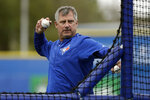 FILE- In this March 13, 2017, file photo, Toronto Blue Jays quality control coach Derek Shelton throws batting practice before a spring training baseball game against the Boston Red Sox in Dunedin, Fla. Shelton is the new manager of the Pittsburgh Pirates, the team announced Wednesday, Nov. 27, 2019. Shelton replaces Clint Hurdle, who was fired on the final day of the regular season in September following a second-half collapse that dropped the Pirates to a last-place finish in the National League Central. (AP Photo/Chris O'Meara, File)