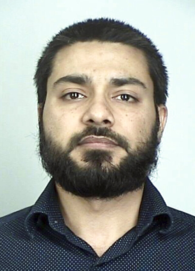 This booking photo provided by the Sherburne County Sheriff shows Muhammad Masood.  A psychological exam was ordered Wednesday, Sept. 16, 2020, for Masood, a Pakistani doctor and former Mayo Clinic researcher accusing of telling paid FBI informants that he pledged allegiance to the Islamic State group and wanted to carry out lone wolf attacks in the U.S.  (Sherburne County Sheriff via AP)