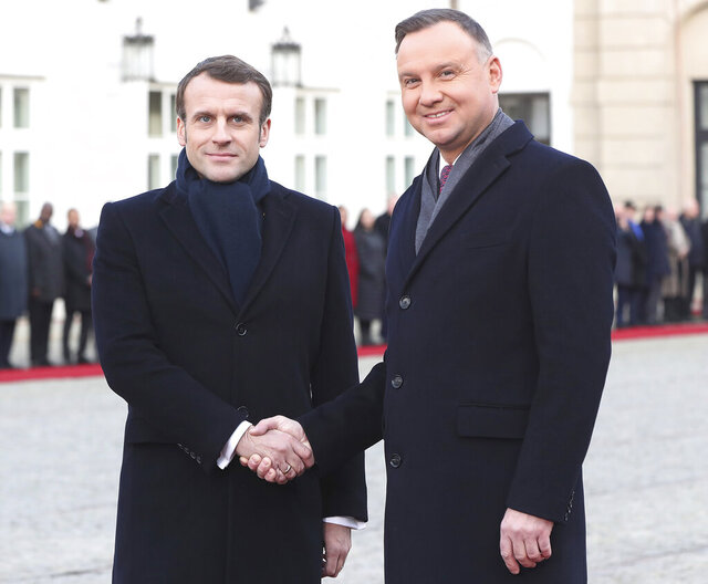 President Emmanuel Macron,left, of France and his Polish host, President Andrzej Duda, shake hands before talks on developing recently-strained bilateral ties at the Presidential Palace in Warsaw, Poland, Monday, Feb. 3, 2020.(AP Photo/Czarek Sokolowski)