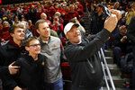 Former Iowa State head coach Fred Hoiberg, center, takes a photo with fans before the Iowa State NCAA college basketball game against Baylor, Tuesday, Feb. 19, 2019, in Ames, Iowa. (AP Photo/Matthew Putney)
