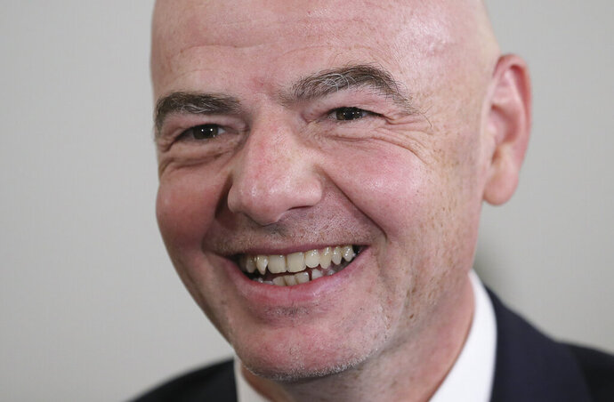 FIFA President Gianni Infantino smiles during an awarding ceremony in the Kremlin in Moscow, Russia, Thursday, May 23, 2019. Putin awarded FIFA President Gianni Infantino with the Order of Friendship and praised the World Cup that Russia hosted last year as the best ever. (Evgenia Novozhenina/Pool Photo via AP)