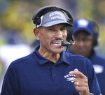 Nevada head football coach Jay Norvell calls instructions from the sidelines during the second quarter of an NCAA college football game against Oregon Saturday, Sept. 7, 2019, in Eugene, Ore. (AP Photo/Chris Pietsch)