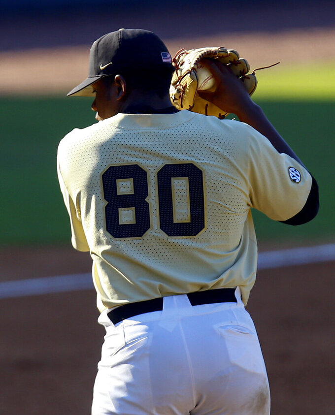 Vanderbilt pitcher Kumar Rocker prepares to throw against LSU during the third inning of the Southeastern Conference tournament NCAA college baseball game, Saturday, May 25, 2019, in Hoover, Ala. (AP Photo/Butch Dill)