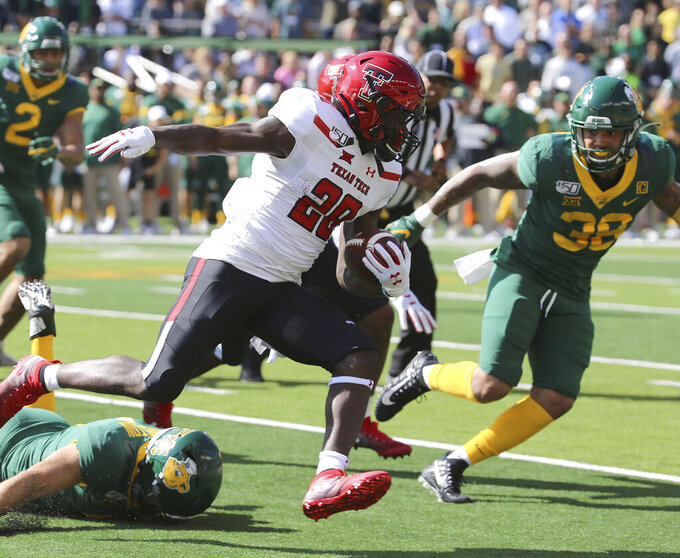 Texas Tech running back SaRodorick Thompson (28) runs against Baylor linebacker Jordan Williams (38) during the first half of a NCAA college football game in Waco, Tex.,Saturday, Oct. 12, 2019.(AP Photo/Jerry Larson)