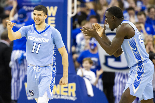 Creighton's Marcus Zegarowski (11) celebrates his game winning three point shot with 3.2 seconds remaining alongside Damien Jefferson during the second half against Providence at the CHI Health Center in  Omaha, Neb., on Saturday, Jan. 18, 2020. (Brendan Sullivan/Omaha World-Herald via AP)