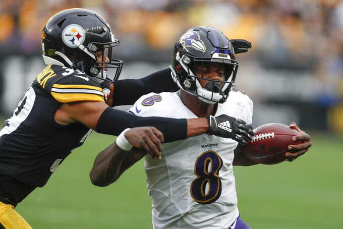 Pittsburgh Steelers free safety Minkah Fitzpatrick (39) tackles Baltimore Ravens quarterback Lamar Jackson (8) as he scrambles during overtime of an NFL football game, Sunday, Oct. 6, 2019, in Pittsburgh. The Ravens won 26-23. (AP Photo/Don Wright)