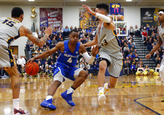 Buffalo guard Davonta Jordan (4) drives against Canisius guard Isaiah Reese (13) during the first half of an NCAA college Basketball game, Saturday, Dec. 29, 2018, in Buffalo N.Y. (AP Photo/Jeffrey T. Barnes)