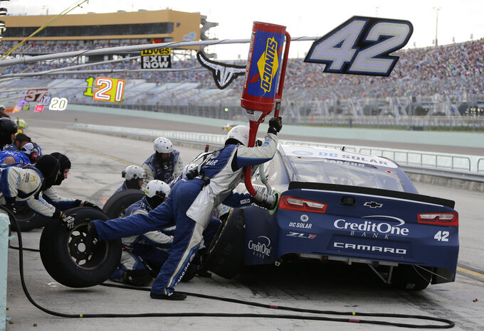 Kyle Larson (42) makes a pit stop during the NASCAR Cup Series Championship auto race at the Homestead-Miami Speedway, Sunday, Nov. 18, 2018, in Homestead, Fla. (AP Photo/Terry Renna)