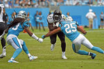 Carolina Panthers strong safety Eric Reid (25) and defensive back Tre Boston (33) look to tackle Jacksonville Jaguars running back Leonard Fournette (27) during the second half of an NFL football game in Charlotte, N.C., Sunday, Oct. 6, 2019. (AP Photo/Mike McCarn)
