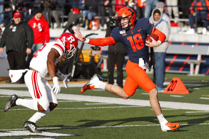 Illinois quarterback Brandon Peters runs for 54-yards as Rutgers defensive back Christian Izien chases during the second half of an NCAA college football game Saturday, Nov. 2, 2019, in Champaign, Ill. (AP Photo/Charles Rex Arbogast)