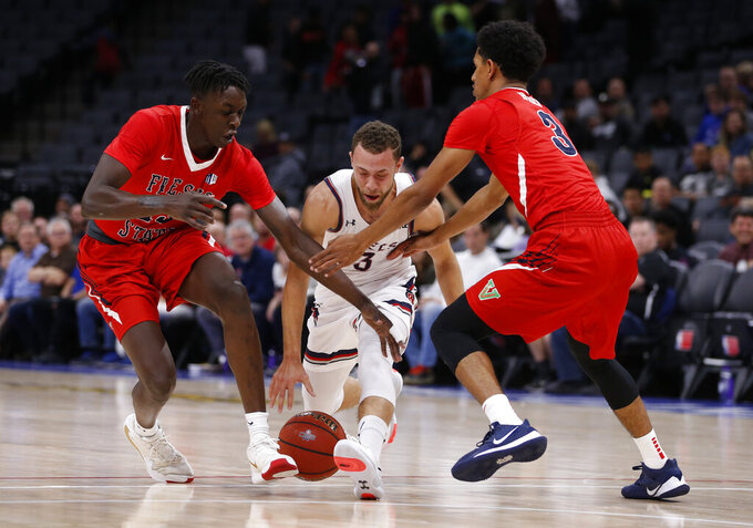 Saint Mary's Jordan Ford is double-teamed by Fresno State's Aguir Agau, left, and Jarred Hyder during the first half of an NCAA college basketball game in Sacramento, Calif., Wednesday, Nov. 20, 2019. (AP Photo/Rich Pedroncelli)