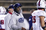 Florida Atlantic coach Willie Taggart speaks to a player during the second half of the team's NCAA college football game against Southern Mississippi, Thursday, Dec. 10, 2020, in Hattiesburg, Miss. (AP Photo/Rogelio V. Solis)