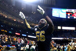 New Orleans Saints outside linebacker Demario Davis (56) celebrates after an NFL football game against the Tampa Bay Buccaneers in New Orleans, Sunday, Oct. 6, 2019. The Saints won 31-24. AP Photo/Butch Dill)