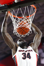 Georgia forward Derek Ogbeide (34) dunks the ball against Vanderbilt during an NCAA college basketball game, Wednesday, Jan. 9, 2019 in Athens, Ga. (Joshua L. Jones/Athens Banner-Herald via AP)