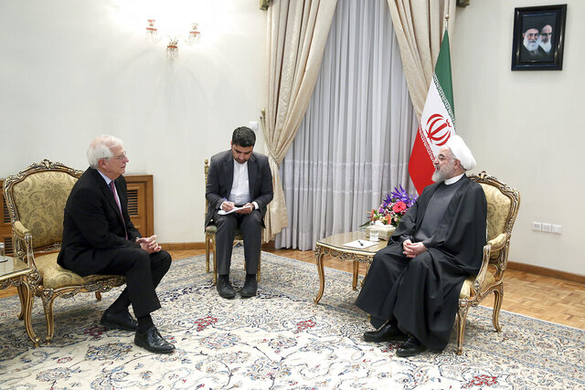 In this photo released by the official website of the Office of the Iranian Presidency, President Hassan Rouhani, right, meets European Union foreign policy chief Josep Borrell at his office in Tehran, Iran, Monday, Feb. 3, 2020. (Office of the Iranian Presidency via AP)