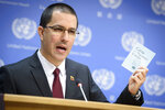 In this photo provided by the United Nations, Jorge Arreaza, Minister of the People's Power for Foreign Affairs of the Bolivarian Republic of Venezuela, speaks to the media at United Nations headquarters, Friday, Feb. 22, 2019. (Loey Felipe/The United Nations via AP)