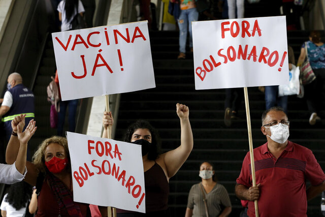 Demonstrators hold the Portuguese messages: