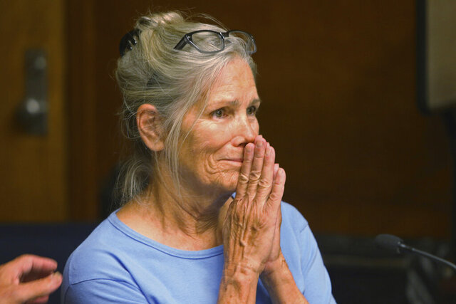 FILE - In this Sept. 6, 2017, file photo, Leslie Van Houten reacts after hearing she is eligible for parole during a hearing at the California Institution for Women in Corona, Calif. A California panel has recommended parole for Charles Manson follower Van Houten, who has spent nearly five decades in prison. The recommendation was made Thursday, July 23, 2020, although Gov. Gavin Newsom could decide to deny it. (Stan Lim/Los Angeles Daily News via AP, Pool, File)