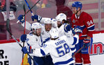 Tampa Bay Lightning's Tyler Johnson (9) celebrates his goal with Mathieu Joseph (7), Pat Maroon (14) and David Savard (58) as Montreal Canadiens' Corey Perry skates by during the second period of Game 3 of the NHL hockey Stanley Cup Final, Friday, July 2, 2021, in Montreal. (Paul Chiasson/The Canadian Press via AP)