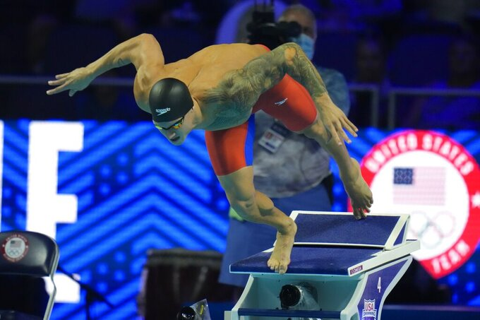 Caeleb Dressel rparticipates in the men's 50 freestyle during wave 2 of the U.S. Olympic Swim Trials on Sunday, June 20, 2021, in Omaha, Neb. (AP Photo/Jeff Roberson)