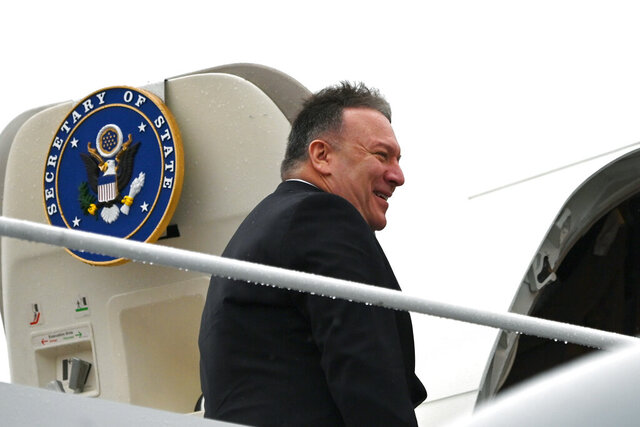 Secretary of State Mike Pompeo, boards a plane as he departs on a multi-country trip, Thursday, Feb. 13, 2020, at Andrews Air Force Base, Md. (Andrew Caballero-Reynolds/Pool via AP)