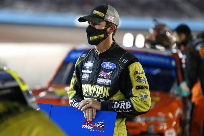 Grant Enfinger looks on from pit lane prior to the NASCAR Truck Series auto race at Phoenix Raceway, Friday, Nov. 6, 2020, in Avondale, Ariz. (AP Photo/Ralph Freso)