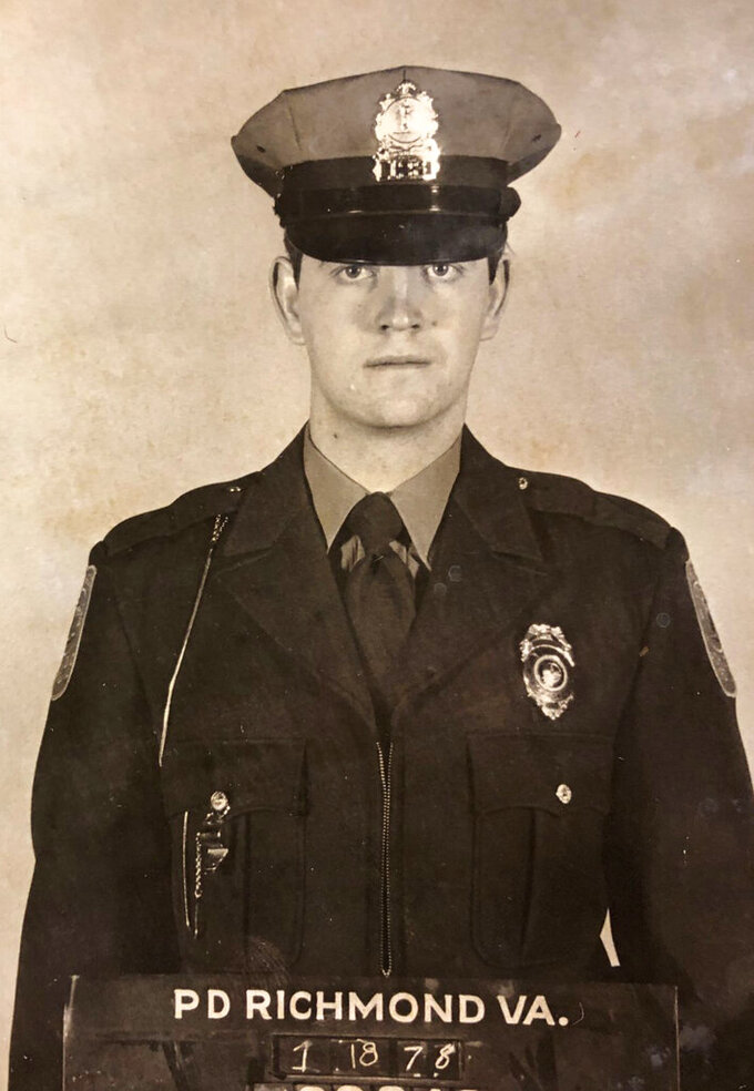 This undated photo provided by the Richmond Police Dept shows Richmond police Officer Michael Connors. The expected release Monday, May 11, 2020 of a man convicted in the 1979 killing of a Richmond police officer was put on hold amid an investigation by Virginia's government watchdog agency into the parole board's handling of the inmate's case, state officials said. (Richmond Police Dept/Richmond Times-Dispatch via AP)