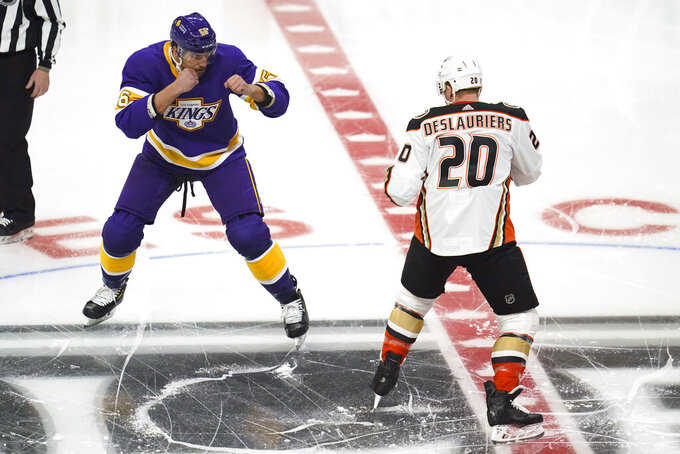 Los Angeles Kings defenseman Kurtis MacDermid (56) and Anaheim Ducks left wing Nicolas Deslauriers (20) square up for a fight during the first period of an NHL hockey game Tuesday, Feb. 2, 2021, in Los Angeles. (AP Photo/Ashley Landis)