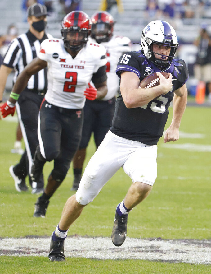 TCU quarterback Max Duggan (15) takes off past Texas Tech linebacker Brandon Bouyer-Randle (2) on a 48-yard touchdown run during the second half of an NCAA college football game Saturday, Nov. 7, 2020, in Fort Worth, Texas. TCU won 34-18. (AP Photo/Ron Jenkins)