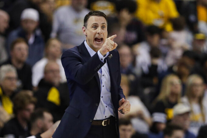Northern Kentucky coach Darrin Horn gestures during the second half of the team's NCAA college basketball game against Illinois-Chicago for the Horizon League men's tournament championship in Indianapolis, Tuesday, March 10, 2020. Northern Kentucky won 71-62. (AP Photo/Michael Conroy)
