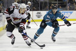 Arizona Coyotes center Nick Cousins (25) skates in front of San Jose Sharks center Tomas Hertl (48), from the Czech Republic, during the first period of an NHL hockey game in San Jose, Calif., Tuesday, Feb. 13, 2018. (AP Photo/Jeff Chiu)